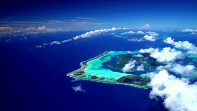 aerial view of tropical south pacific islands - isola di tahaa video stock e b–roll