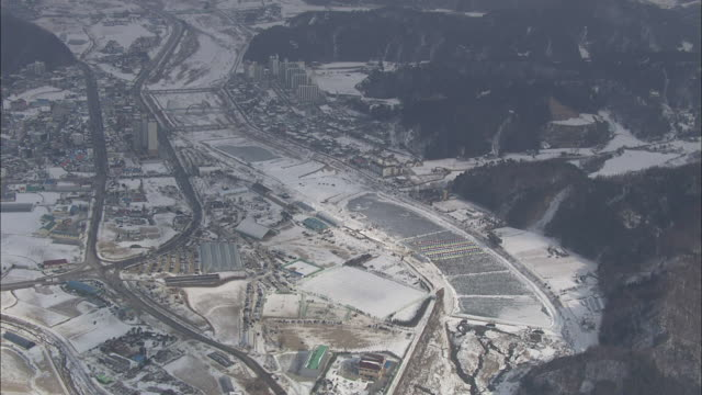 aerial view of trout catching festival at snow covered pyeongchang - trout stock videos and b-roll footage