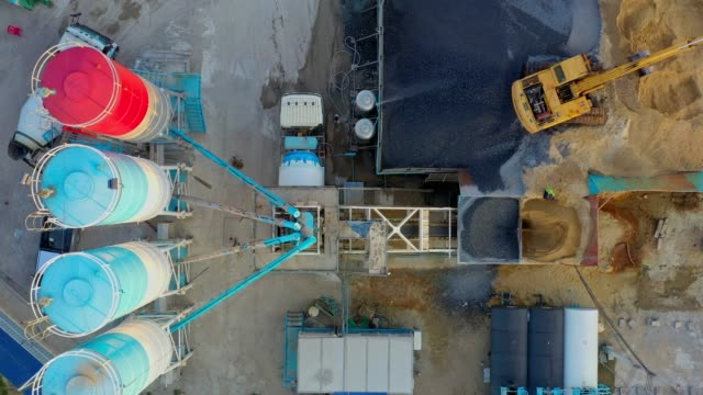 aerial view of truck mixer stands on site and excavator of the concrete plant - concrete stock videos & royalty-free footage