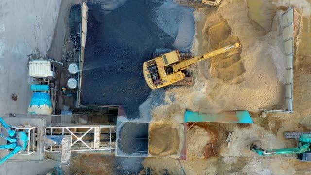 aerial view of truck mixer stands on site and excavator of the concrete plant - cement stock videos & royalty-free footage
