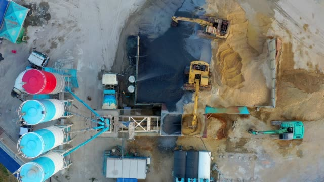 aerial view of truck mixer stands on site and excavator of the concrete plant - calcestruzzo video stock e b–roll
