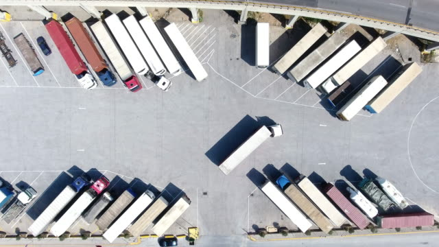 aerial view of trucks and trailers - car park stock videos & royalty-free footage