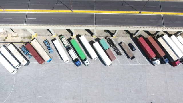 aerial view of trucks and trailers - car park stock videos and b-roll footage