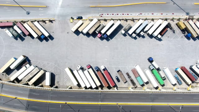 aerial view of trucks and trailers - trucks in a row stock videos & royalty-free footage