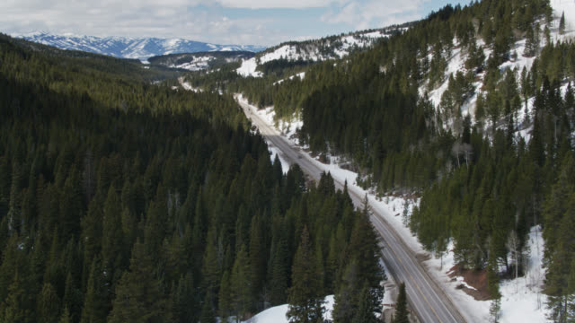 aerial view of trucks on teton pass highway - grand teton stock videos & royalty-free footage