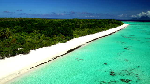 aerial view of tupai and bora bora island - pazifikinseln stock-videos und b-roll-filmmaterial