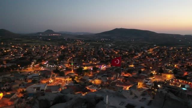 aerial view of turkish flag on cappadocia, turkey - sunset time - rock hoodoo stock videos & royalty-free footage