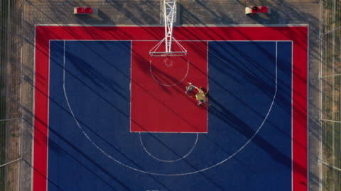 aerial view of two basketball player on basketball court - sports court stock videos & royalty-free footage