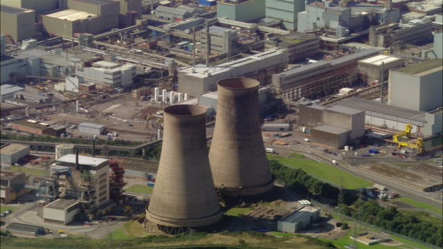 aerial view of two cooling towers at sellafield nuclear site / cumbria, england - sellafield nuclear power station stock videos & royalty-free footage