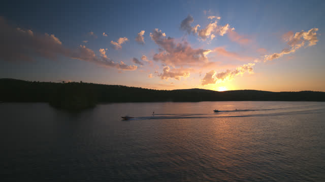 aerial view of two waters-skiers on a beautiful lake at sunset - beauty stock videos & royalty-free footage