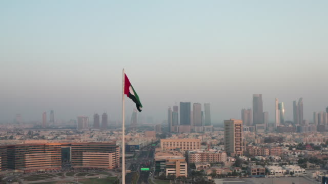 aerial view of uae national flag, united arab emirates flag waving in the air - flag stock videos & royalty-free footage
