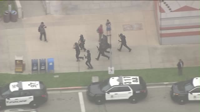 ktla aerial view of ucla shooting which was deemed a murdersuicide - los angeles police department stock-videos und b-roll-filmmaterial