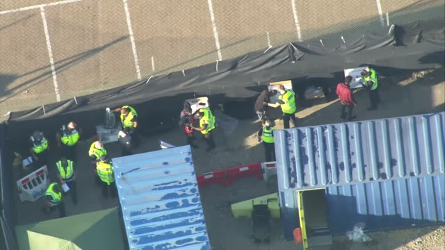 """vidéos et rushes de aerial view of uk customs officials in dover checking in migrants rescued crossing the english channel - """"bbc news"""""""