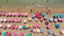 Aerial View of Umbrellas in a Beach of Aegean Sea