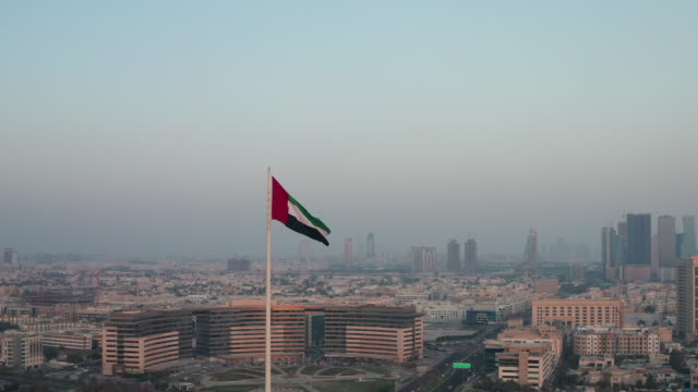 aerial view of united arab emirates (uae) flag located in dubai - flag stock videos & royalty-free footage