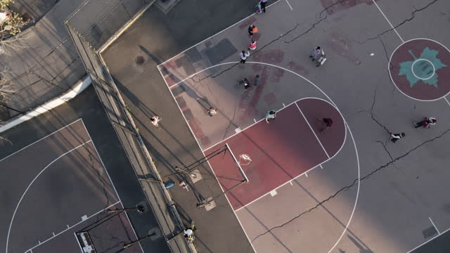 aerial view of unrecognizable kids playing basketball - park city stock videos & royalty-free footage