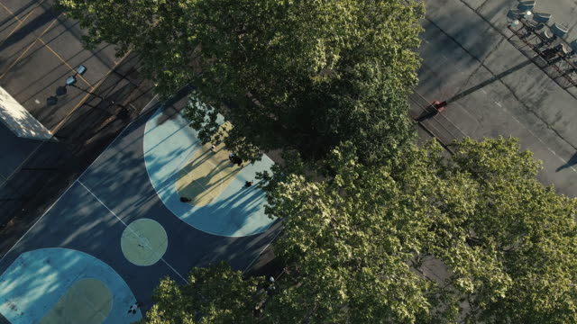 aerial view of unrecognizable people playing basketball in a new york city park - district stock videos & royalty-free footage