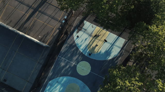 aerial view of unrecognizable people playing basketball in a new york city park - public park stock videos & royalty-free footage