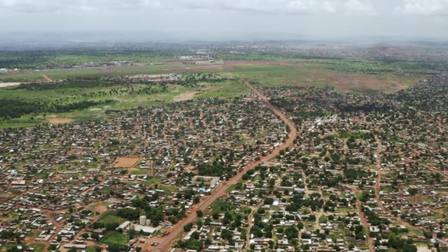 aerial view of urban sprawl of lagos, nigeria - air pollution stock videos & royalty-free footage