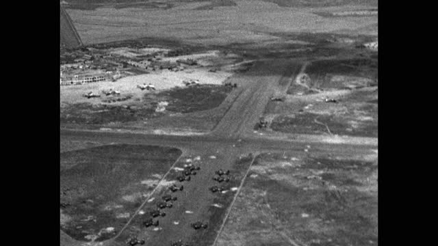 aerial view of us airfield with airplanes on runway, korean war - aircraft point of view stock videos & royalty-free footage