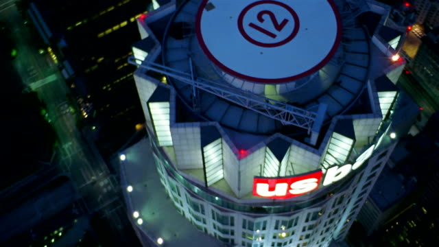 aerial view of us bank building (library tower) and helipad at night / los angeles - helipad stock videos & royalty-free footage