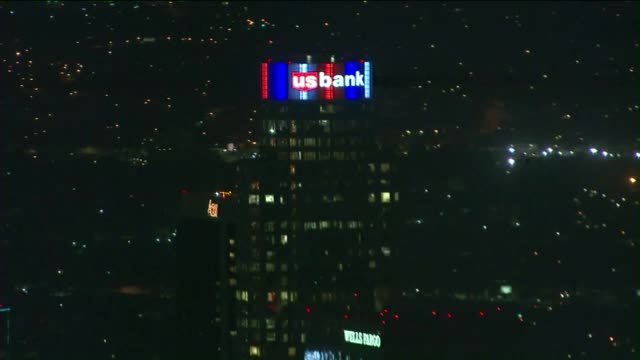 ktla aerial view of us bank tower illuminated in the french flag's colors following deadly attacks - us bank tower stock videos & royalty-free footage