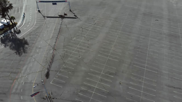 aerial view of vacant parking lots due to covid-19 event cancellations. - road marking stock videos & royalty-free footage