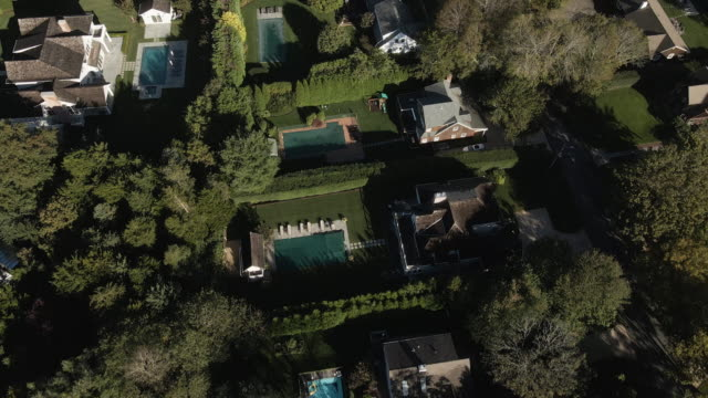 aerial view of vacation homes in the hamptons on an autumn morning - long island video stock e b–roll