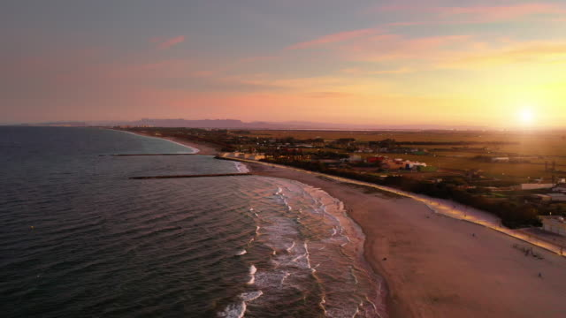 aerial view of valencia saler beach at sunset - coastline stock videos & royalty-free footage