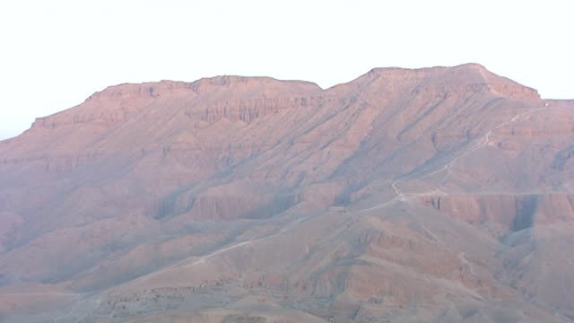 aerial view of valley of the kings, deir el bahari, at dawn. - tempio di hatshepsut video stock e b–roll