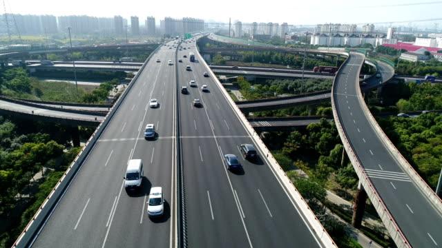 aerial view of var run on the overpass at shanghai,china - 方向標識点の映像素材/bロール