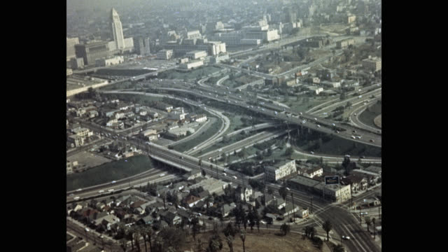 aerial view of vehicles driving on highway in city, los angeles, california, usa - 1950 stock-videos und b-roll-filmmaterial