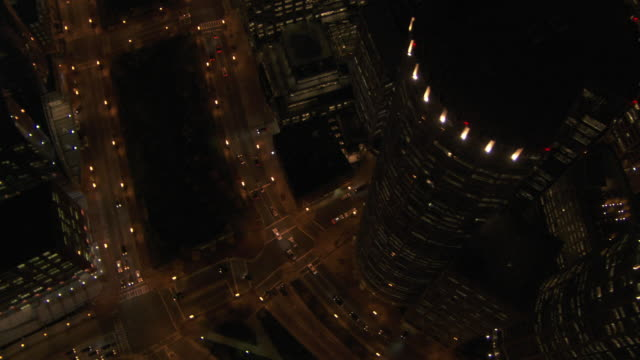 aerial view of vehicles driving on street near two international place at night, boston, massachusetts, united states of america - human settlement stock videos & royalty-free footage