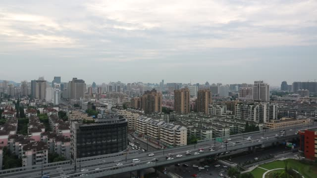 aerial view of vehicles moving on freeway against downtown buildings,hangzhou - zhejiang province stock videos & royalty-free footage