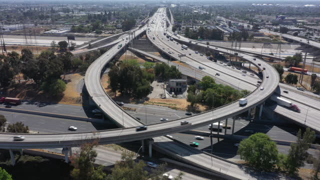 aerial view of vehicles travel along the california sr 91 and interstate 710 freeway interchange in long beach ahead of memorial day weekend, ca,... - long beach california stock videos & royalty-free footage