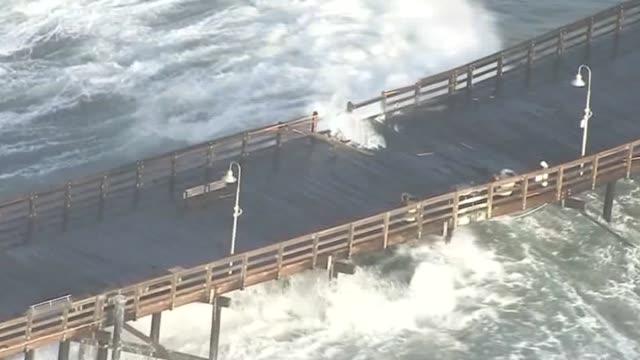 ktla aerial view of ventura high surf and damaged pier - ventura stock videos and b-roll footage