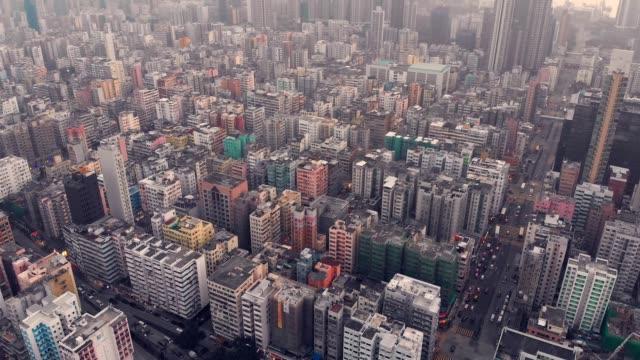 vídeos de stock, filmes e b-roll de aerial view of very crowded hong kong district at sunset - mong kok