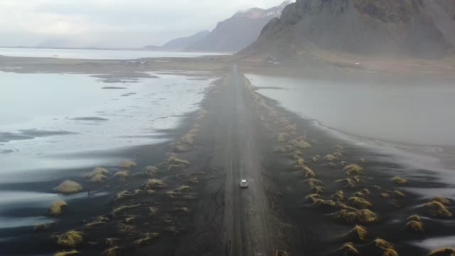 aerial view of vestrahorn mountains near the sea - camper van stock videos and b-roll footage