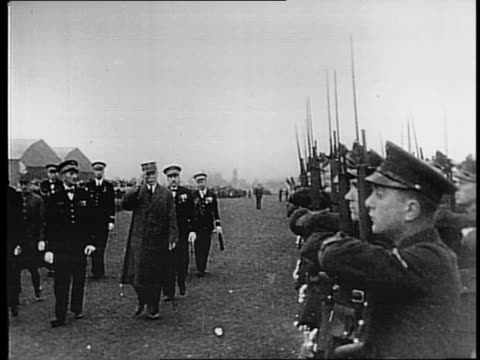 Aerial view of Vichy / Philippe Petain saluting French soldiers / close up of Petain / view of Petain and officials with soldiers in foreground /...