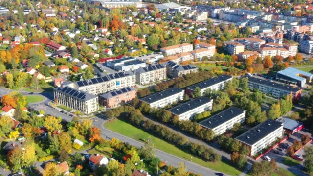 aerial view of villa and apartment area, fall colors. note the solar cells - sweden stock videos & royalty-free footage