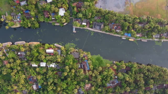 aerial view of village and river in alleppey backwaters - backwater stock videos & royalty-free footage