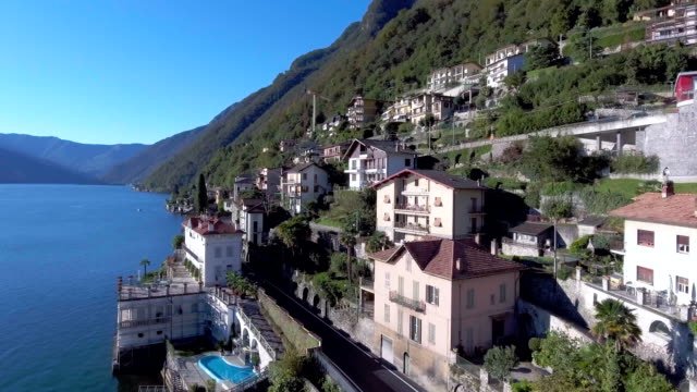 aerial view of village at lake - italy stock videos & royalty-free footage