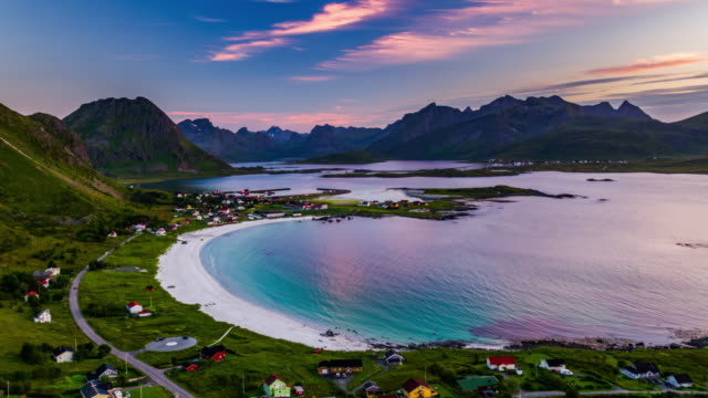 Aerial view of village at the Lofoten Islands in Norway with beautiful sandy beach at sunset