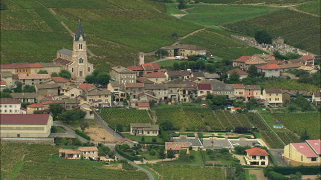 WS Aerial view of Village in Beaujolais region surrounded by vineyards, Rhone-Alpes, France