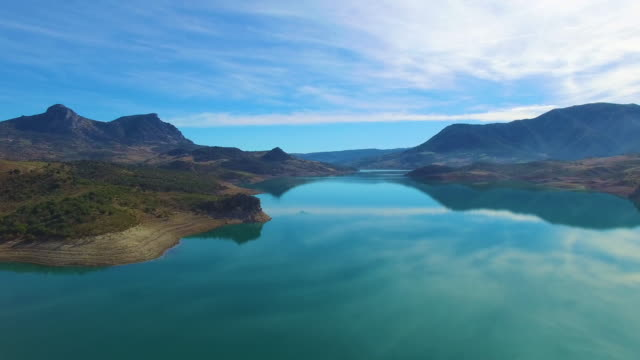 vidéos et rushes de aerial view of village in beautiful lake with reflection - grandiose