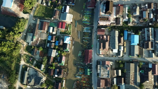 aerial view of village  inle ,boat on river,agriculture tomatos on floating garden myanmar - myanmar stock videos & royalty-free footage