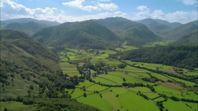 Aerial view of village of Rosthwaite criss-crossed by roads and surrounded by fells / Lake District, Cumbria, England
