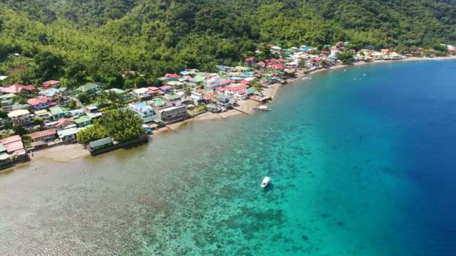 aerial view of village spread along anilao beach - philippines stock videos & royalty-free footage