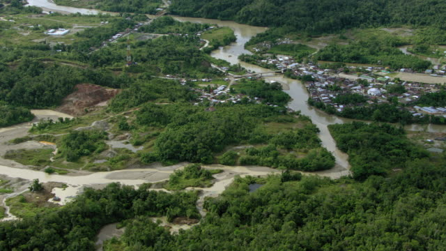 vidéos et rushes de aerial view of village surrounded by lush landscape, colombia - colombie