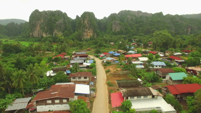 Aerial view of Village with limestone mountain at Noen Maprang in Thailand